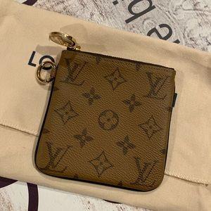 Authentic LV square pouch in reverse monogram